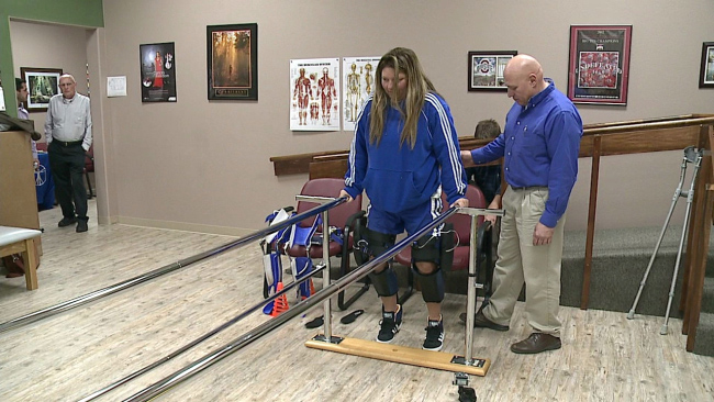 Proving the insurance companies wrong, Stacey works on walking with her C-Brace.