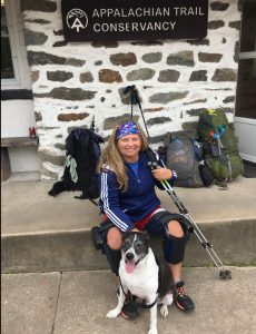 Stacey Kozel and a friend take a break on the Appalachian Trail.