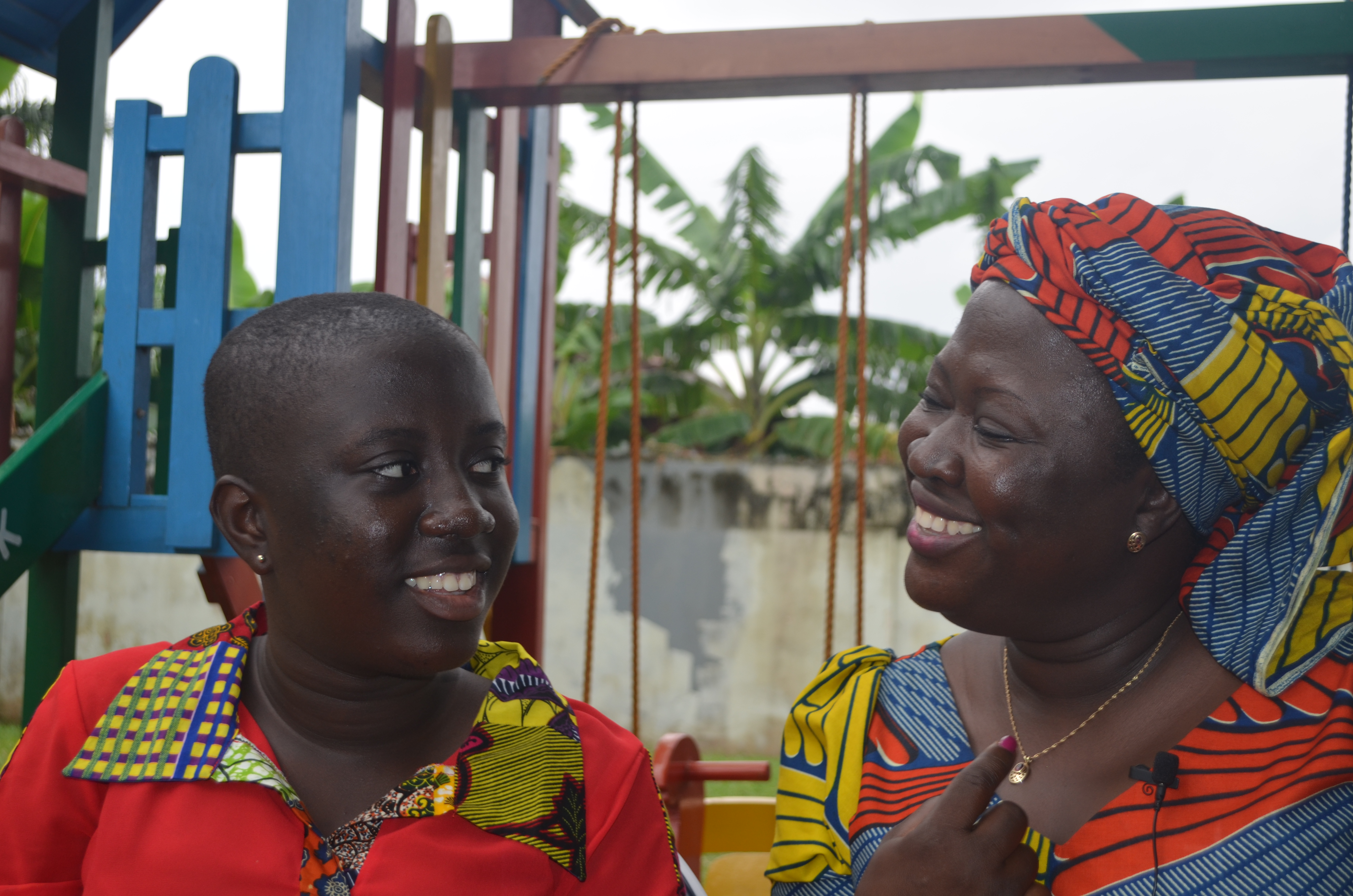 Renata and her mother share a smile of understanding.