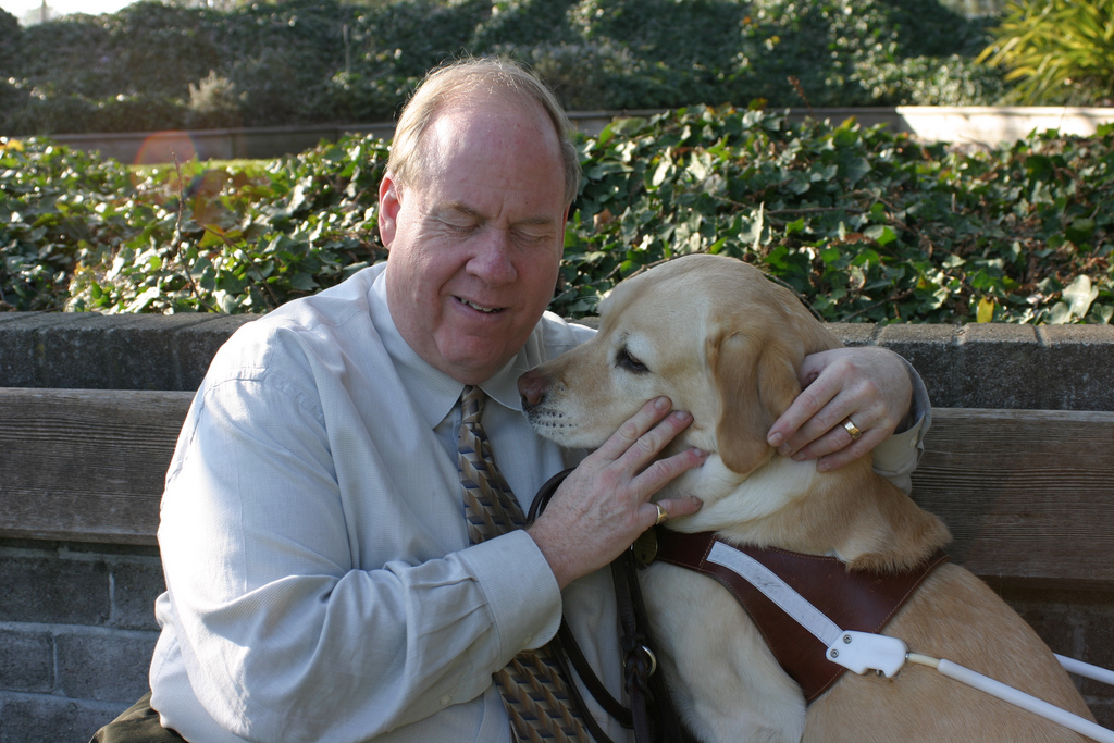 Mike and his guide dog, Roselle.