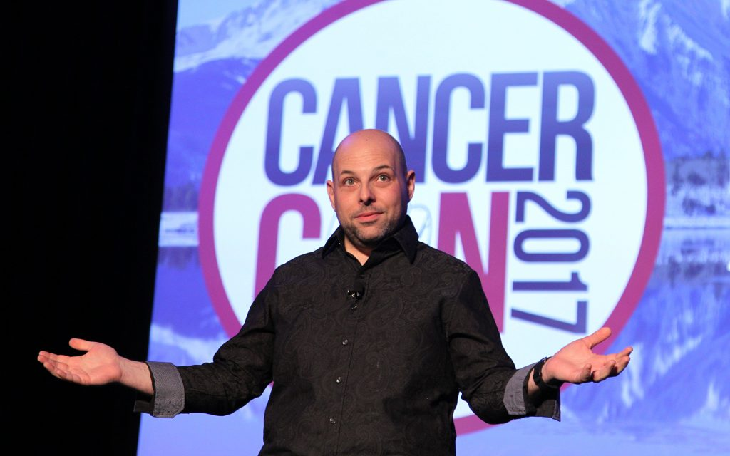 Matthew Zachary speaking at Cancer Con.