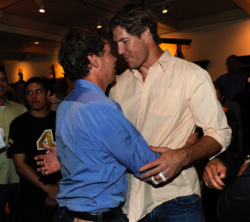Steve hugs Scott Fujita at a Super Bowl Ring Party, thrown in 2011 in Steve's honor.