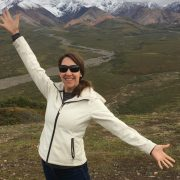 A blind woman with occult macular generation standing before Denali.