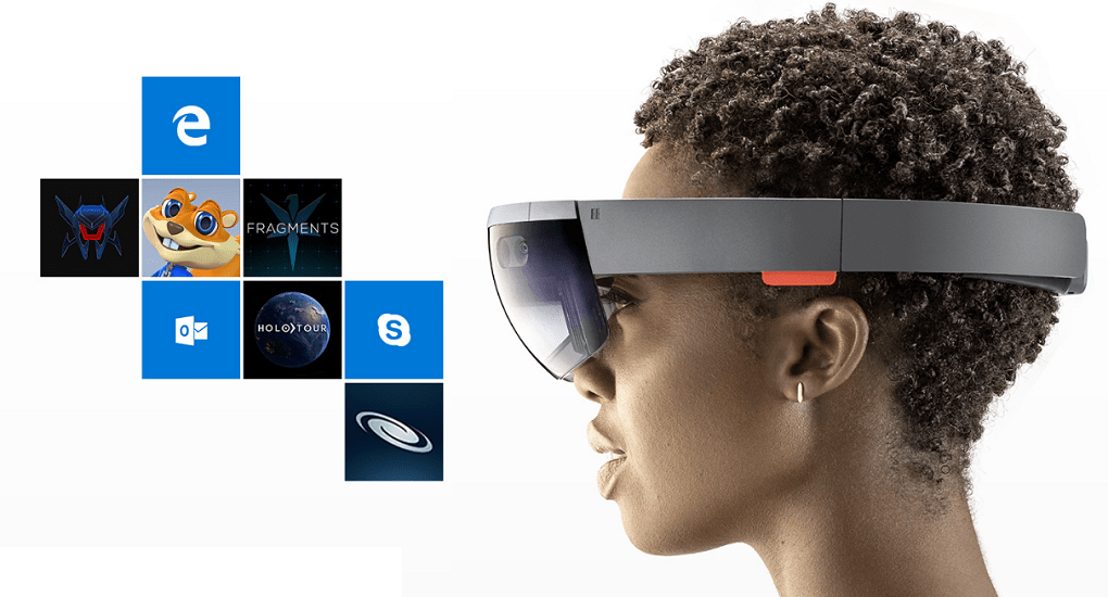 A black woman with short hair wearing a Microsoft Hololens augmented-reality headset,