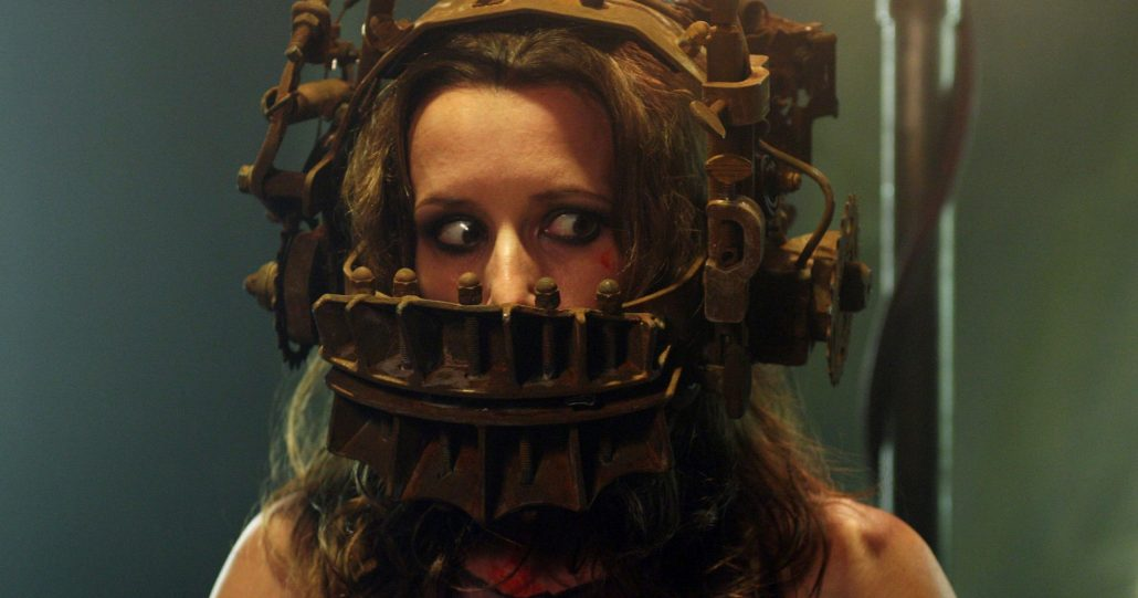 A woman in a rusty torture device.